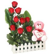 Artistic Nine Red Roses and a Teddy with Heart