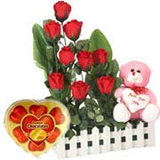 Appealing Triad of Lovely Teddy, Chocolates and Flowers