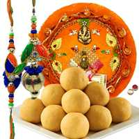 Graceful Set Of Bhaiya Bhabhi Rakhi, Pooja Thali And Luscious Besan Laddoo