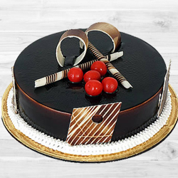 Tasty delicious dark Chocolate Truffle Cake to Kodamballi
