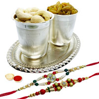 Special dry fruit hamper in Silver plated Glass and tray with 2 free Rakhi, Roli tilak and Chawal
