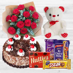 Awesome Bouquet of 12 Dutch Red Roses with 1 Lb Cake, Mixed Cadburys Chocolates and a Teddy Bear