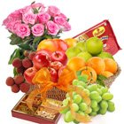 Elegance of Fresh Fruits Basket with Tasty Haldiram Soan papdi and Rose Bouquet