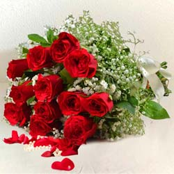 Expressive Blooming Happiness Bouquet of 12 Red Roses to Domlur