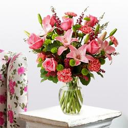 Heavenly Arrangement of Lilies, Roses and Carnations with a Circus of Celebration