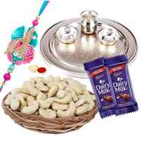 Admirable Rakhi Special Gift of One Silver Puja Thali with One Fancy Rakhi and Spicy Cashew Nuts