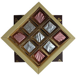 Mesmerising Gift of 9 Pcs Assorted Homemade Chocolates