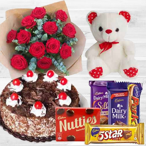 Awesome Bouquet of Dutch Red Roses with Cake, Mixed Cadburys Chocolates and a Teddy Bear