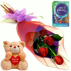 Vibrant Red Rose Array, Cute Teddy and Cadbury Assortment Mini Pack