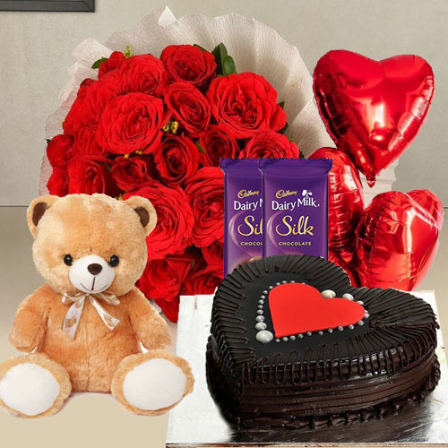 Captivating Red Roses, Chocolate Cake, Mylar Balloons, Chocolates and a Teddy