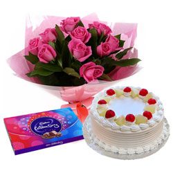 Beautiful Arrangement of Pink Rose, Cadbury Celebration and Cake