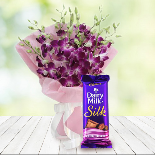 Online Gift of Orchids Bouquet and Dairy Milk Silk Chocolate