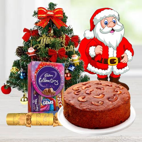 """Christmas Fruit Cake 1 Lbs. with Christmas Tree 1 Ft. long artificial, Assorted Cadbury""""s Chocolates for hanging ( 130 G.), Star and Bells for decoration, Santa Claus and  Handheld Ribbon Crackers for Christmas"""