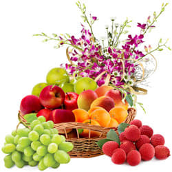 Refreshing Fresh Fruits Basket Hamper with Orchid Decor
