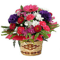 Lovely colorful Flower arrangement in a Bamboo Pot