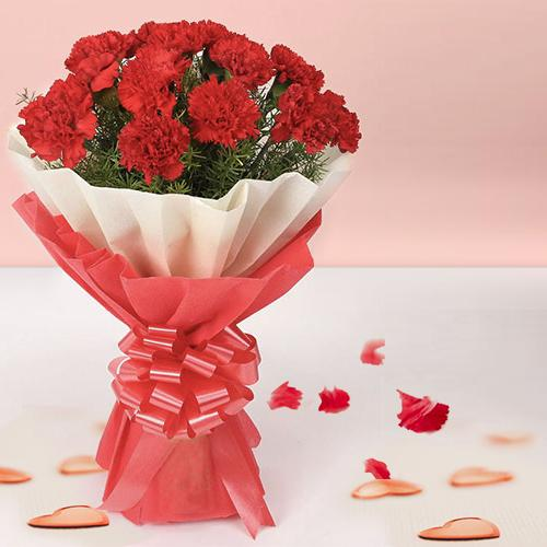 Now deliver this delicate Hand Bunch of Red Carnations in tissue