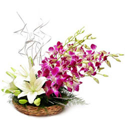 Blooming White lilies with Orchids Basket Arrangement